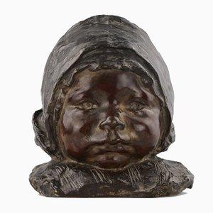 Busto de bronce de una niña