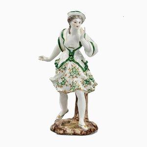 Figura de porcelana de dama en verde