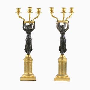 Candeleros estilo Imperio de bronce. Juego de 2