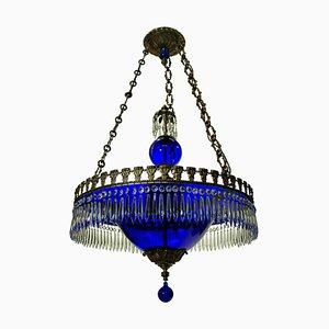 Lámpara de araña vintage de vidrio azul