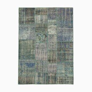 Alfombra gris de patchwork