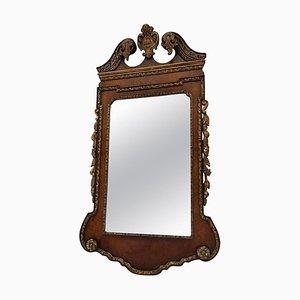 Specchio antico in legno di noce intagliato e dorato