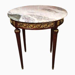 Mesa auxiliar de estilo Luis XVI con tablero de mármol