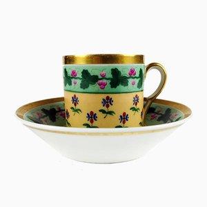 Tazza da caffè antica in porcellana