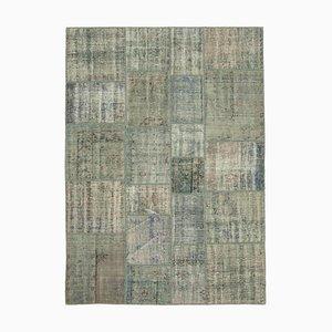 Grauer Patchwork Teppich