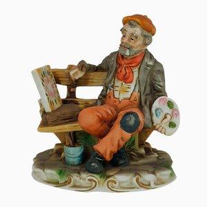 Borde de bellas artes, vagabundo sentado en un banco y pintura
