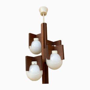 Lampada a sospensione a 4 luci in vetro opalino e legno, anni '70