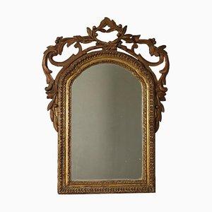 Espejo dorado tallado
