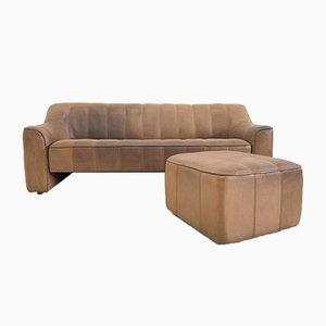 Vintage DS 44 3-Sitzer Sofa & Fußhocker von de Sede, 1970er, 2er Set
