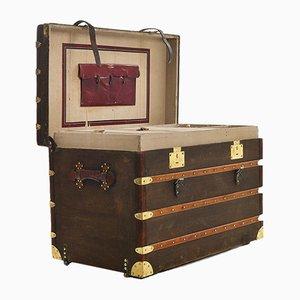 Baule in ottone e pelle con armadietti in legno di Moynat