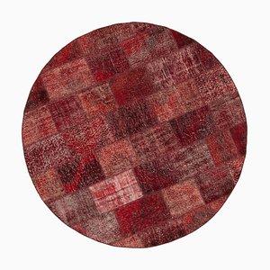 Roter runder Patchwork Teppich