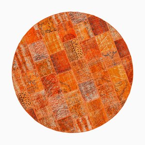 Orangefarbener runder Patchwork Teppich