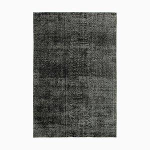 Schwarzer Überfärbter Teppich