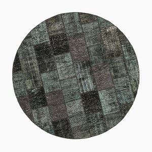 Schwarzer runder Patchwork Teppich