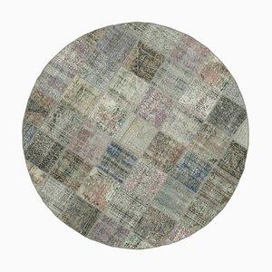 Grauer runder Patchwork Teppich