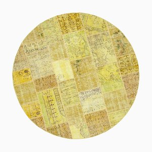 Gelber runder Patchwork Teppich
