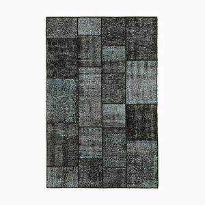 Schwarzer Patchwork Teppich