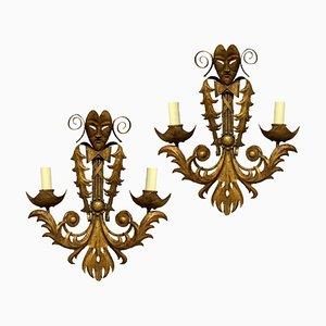 Lámparas de pared venecianas de metal dorado. Juego de 2