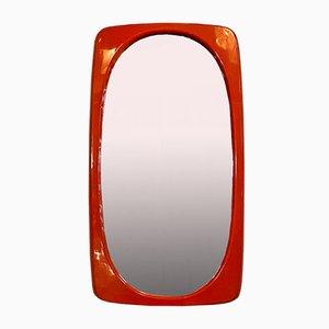 Espejo italiano Mid-Century moderno de plástico naranja con marco irregular, años 70