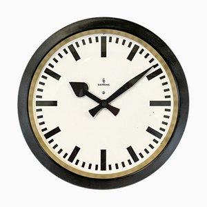 Reloj de pared industrial en negro de Siemens, años 50