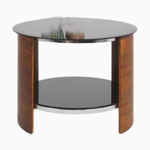 Mesa de centro inglesa redonda con tablero de vidrio negro, años 60