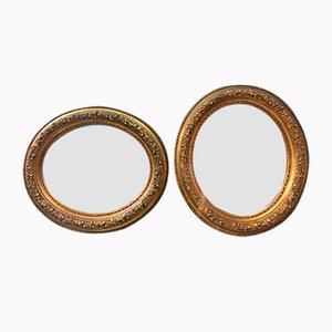 Espejos italianos ovales dorados con pan de oro, década de 1900. Juego de 2