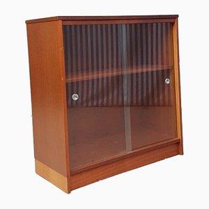 Mueble Mid-Century compacto de teca con frontal de vidrio
