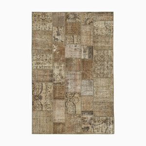 Alfombra marrón de patchwork
