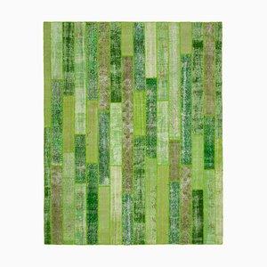 Grüner Patchwork Teppich