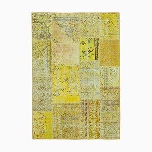 Gelber Patchwork Teppich