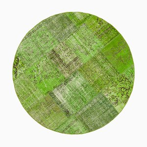 Grüner runder Patchwork Teppich