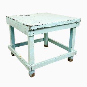 Mesa industrial vintage con tablero de zinc azul