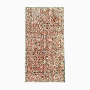 Roter Überfärbter Teppich