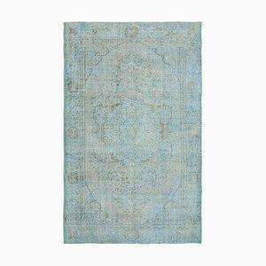 Blauer Überfärbter Teppich