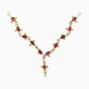 0,66 Karat ovale Rubine und 0,11 Karat runde Diamanten an einer 18 Karat Gelbgold-Halskette