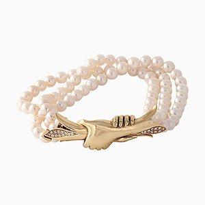 Brazalete de perlas con cierre de diseño de oro de 18 kt y diamantes de 0,30 kt