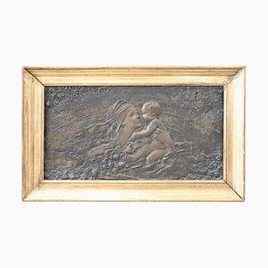 Escultura modernista de bronce con marco