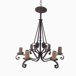 Lámpara de araña de hierro forjado con seis luces en forma de vela, años 20