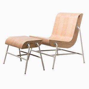 Sedia Overlap con poggiapiedi con struttura in metallo di Nadav Caspi