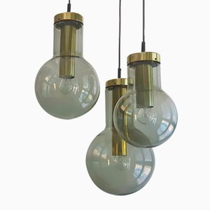 Chandelier with 3 Glass and Brass Maxi Globe Pendant Lamps from Raak, the Netherlands, 1960s