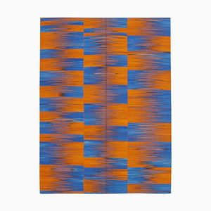 Orangefarbener Kelim Teppich