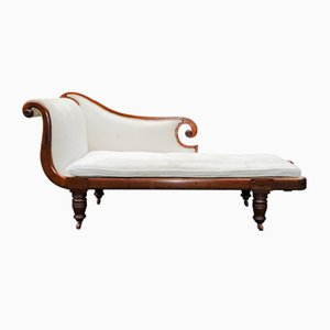 English Regency Chaise Longue in Mahogany with Loose Cream Cushion, Turned Legs & Porcelain Castors