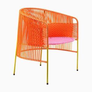 Orange & rosa Caribe Sessel von Sebastian Herkner