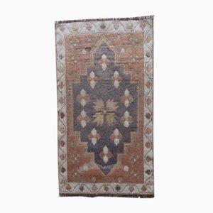 Kleine türkische handgeknüpfte Fußmatte oder Yastik Teppich