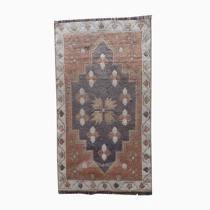 Small Turkish Distressed Hand-Knotted Low Pile Bath Mat or Yastik Rug