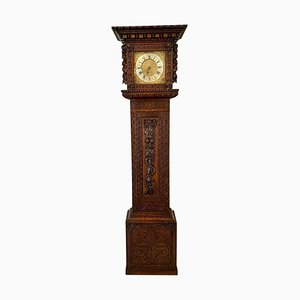 Carved Oak and Brass Face Grandfather Clock