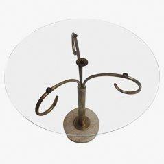 Mesa auxiliar vintage redonda de latón y vidrio, años 50