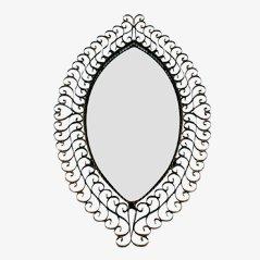 Espejo vintage con forma de ojo de hierro
