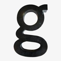 Metal letter g