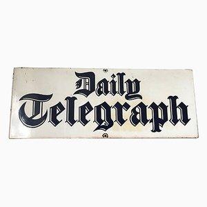 Cartel publicitario del periódico Daily Telegraph esmaltado, años 50